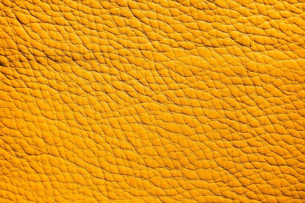 Gelbe lederstruktur-hintergrundoberfläche der extrem nahen nahaufnahme Kostenlose Fotos