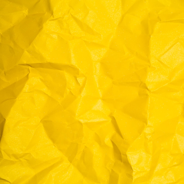 Gelbe papierbeschaffenheit mit kopienraum Kostenlose Fotos