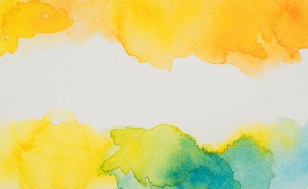 Gelbe und blaue aquarellflecken Kostenlose Fotos