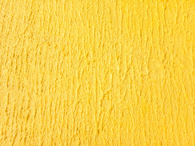 Gelbe wandbeschaffenheit. Premium Fotos