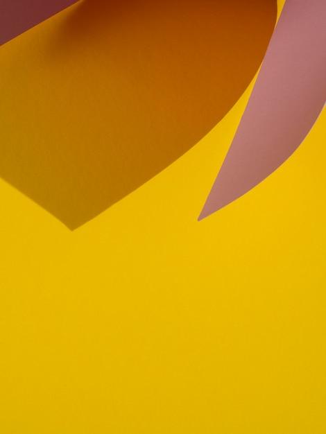 Gelber exemplarplatz des abstrakten papiers formt mit schatten Kostenlose Fotos