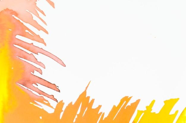 Gelber und orange pinselstrich auf weißem hintergrund Kostenlose Fotos
