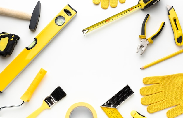 Gelber werkzeugrahmen mit kopienraum Kostenlose Fotos