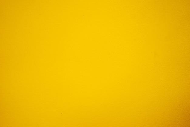 Gelber zementboden, helle schattenfarbe. Premium Fotos