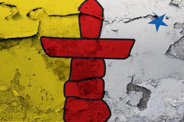 Gemalte nationalflagge von nunavut auf einer betonmauer Premium Fotos
