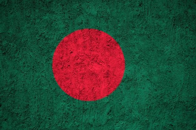 Gemalte staatsflagge von bangladesch auf einer betonmauer Premium Fotos