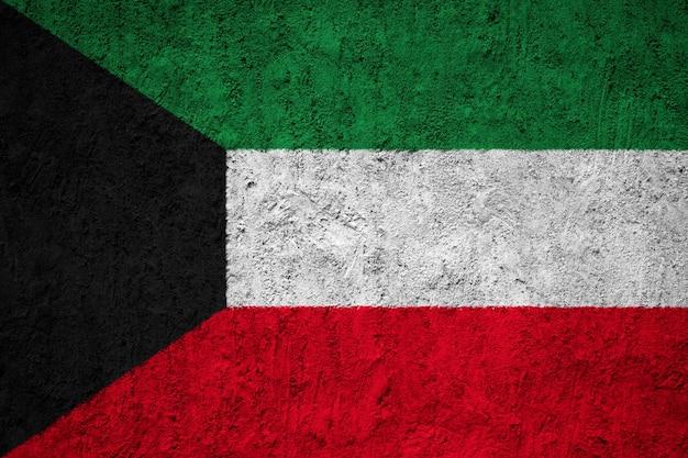 Gemalte staatsflagge von kuwait auf einer betonmauer Premium Fotos