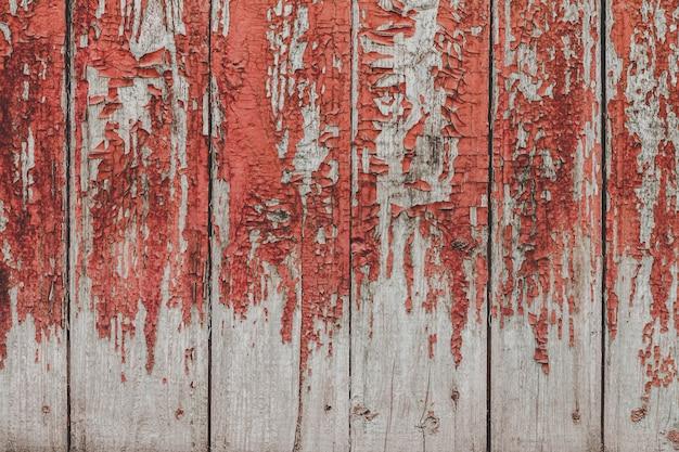 Gemalter alter hölzerner roter wandhintergrund. Premium Fotos