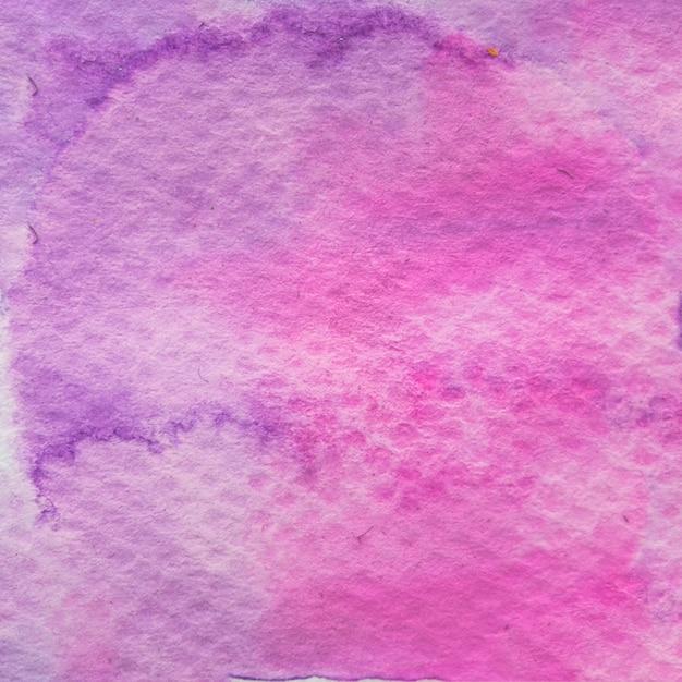 Gemaltes strukturiertes papier mit rosa und purpurroter wasserfarbe Kostenlose Fotos