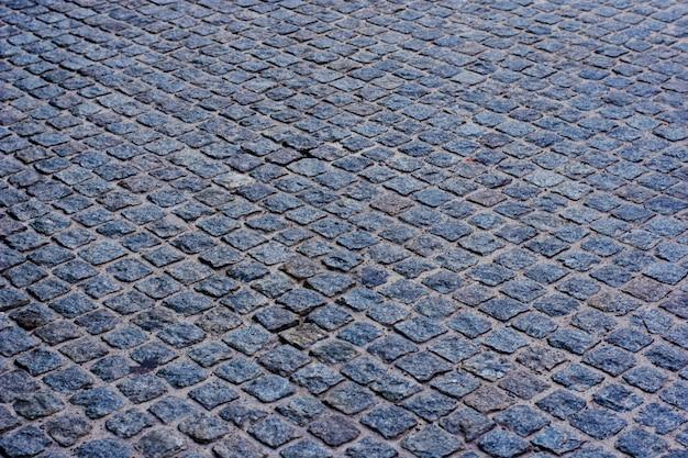 Geometriemuster der traditionellen steinpflasterung des kopfsteins Premium Fotos