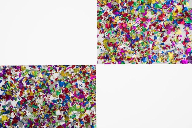 Geometrische form zwei gemacht mit bunten konfettis auf weißem hintergrund Kostenlose Fotos