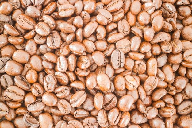 Gerösteter kaffeebohne strukturierter hintergrund Premium Fotos