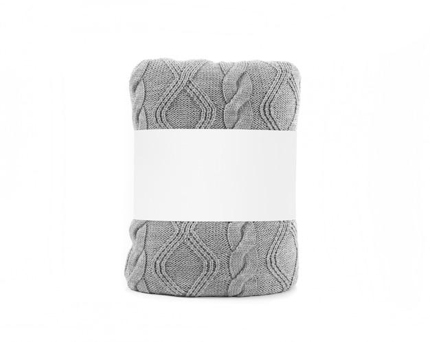 Gerolltes graues plaid mit leerem weißem aufkleber. vorderansichtfoto bereit zum spott oben. Premium Fotos