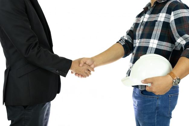 Geschäfts-geschäftsmann- und ingenieurhand, die hand rüttelt erfolgreiches abkommen herein lokalisiert. Premium Fotos