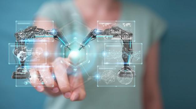 Geschäftsfrau, die roboterarme mit digitalem schirm verwendet Premium Fotos