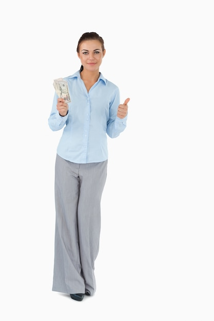 Geschäftsfrau mit banknoten daumen aufgeben Premium Fotos