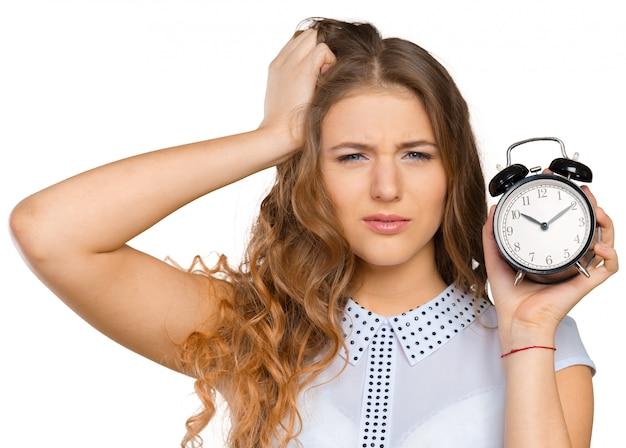 Geschäftsfrau mit uhr zu spät für ihre leistungen Premium Fotos