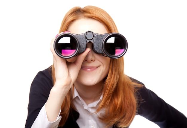 Geschäftsfrauen, die mit binokularem suchen Premium Fotos