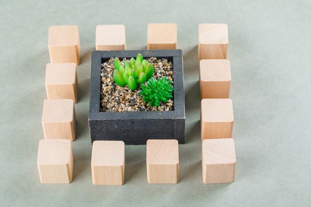 Geschäftskonzept mit holzklötzen, grüne pflanze. Kostenlose Fotos