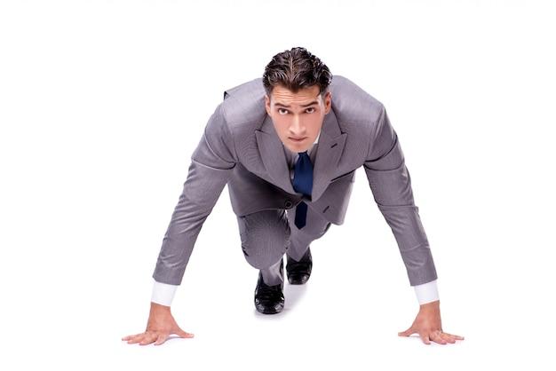 Geschäftsmann auf dem anfang bereit zum laufen lokalisiert auf weiß Premium Fotos