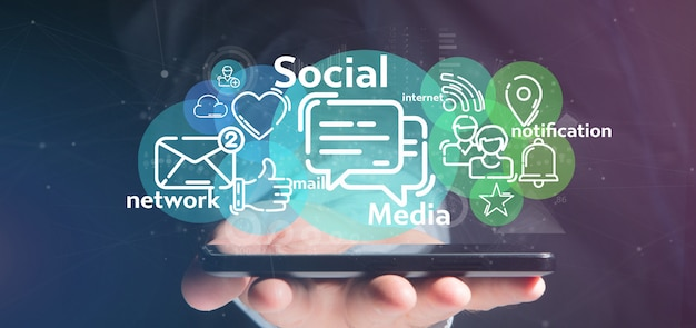 Geschäftsmann, der eine wolke der social media-netzikone hält Premium Fotos