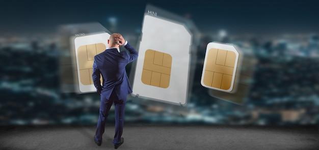 Geschäftsmann, der unterschiedliche größe einer wiedergabe der smartphone sim karte 3d hält Premium Fotos