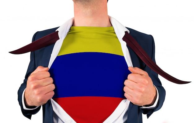 Geschäftsmann eröffnung shirt kolumbien flagge zu enthüllen Premium Fotos