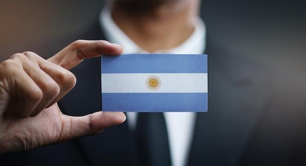 Geschäftsmann holding card von argentinien flagge Premium Fotos