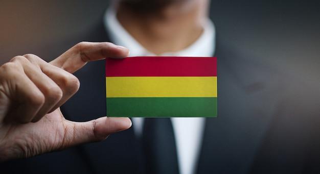 Geschäftsmann holding card von bolivien flagge Premium Fotos