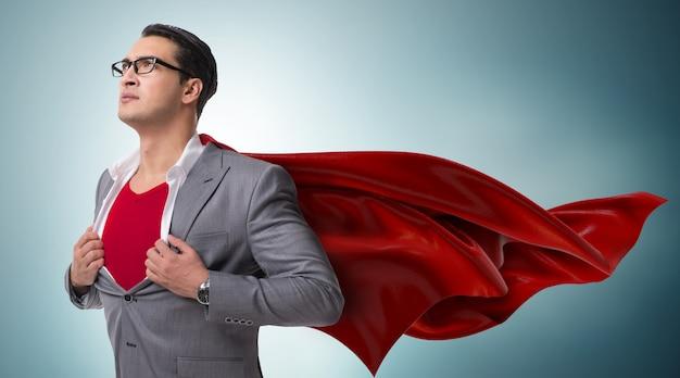 Geschäftsmann im superheldkonzept mit roter abdeckung Premium Fotos