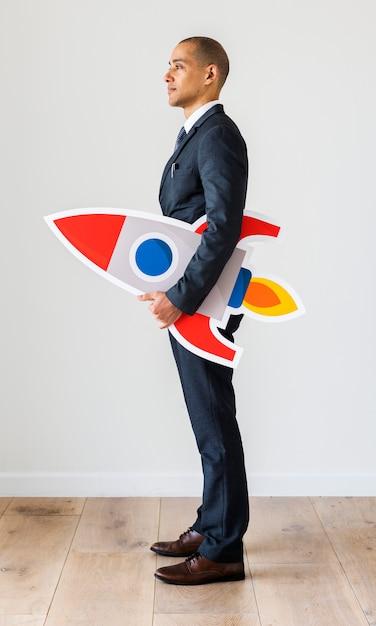 Geschäftsmann, stehend mit symbolen Premium Fotos