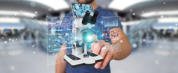 Geschäftsmann unter verwendung des modernen mikroskops mit digitaler analyse Premium Fotos