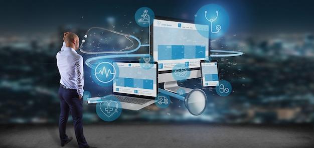 Geschäftsmann vor geräten mit medizinischer wiedergabe der ikone und des stethoskops 3d Premium Fotos