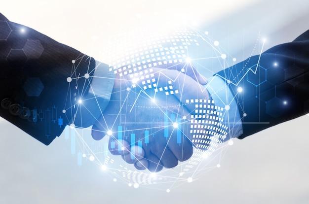 Geschäftsmannhändedruck mit globaler weltkartennetzwerkverbindungsverbindung des effektes und diagrammdiagramm des grafischen diagramms der börse Premium Fotos