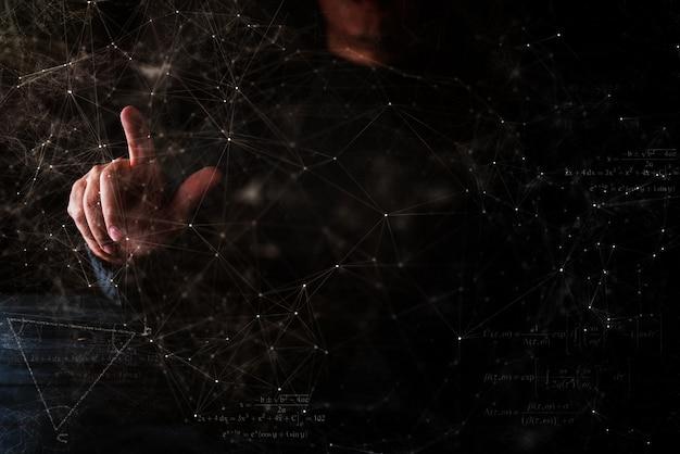 Geschäftsmannhandshow etwas in der hand dunkles blackground Premium Fotos