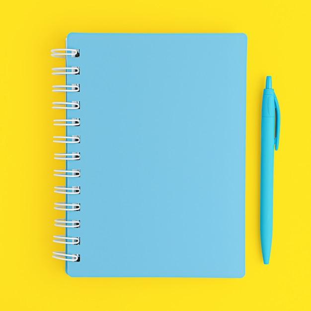 Geschlossenes blaues notizbuch und stift auf gelbem hintergrund. draufsicht, modell. Premium Fotos