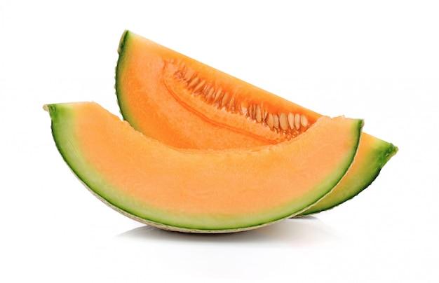 Geschnittene melone melone isoliert auf weiß Premium Fotos