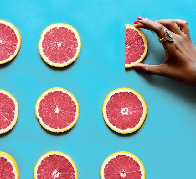 Gesunde geschmackvolle geschnittene zitrusfrüchte Kostenlose Fotos