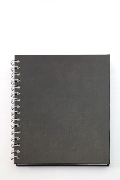 Getrenntes schwarzes notizbuch mit festem einband mit ringmappe auf weiß Premium Fotos
