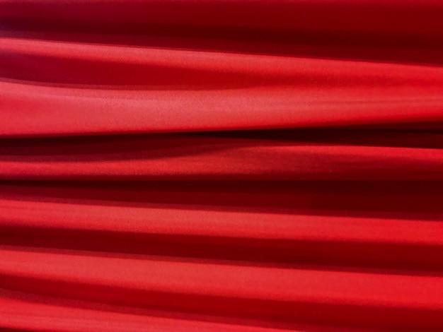 Gewebestoff-beschaffenheitshintergrund der horizontalen luxuriösen spinnenden kurve roten. Premium Fotos
