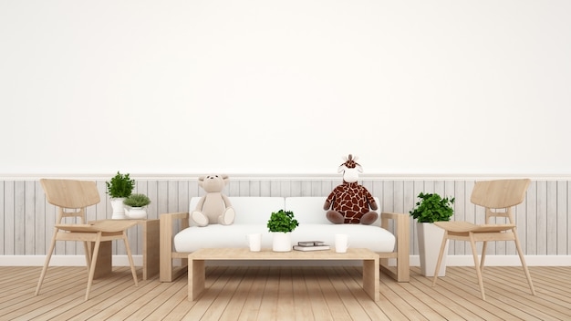 Giraffenpuppe mit bärenpuppe im wohnzimmer oder im kinderraum - wiedergabe 3d Premium Fotos
