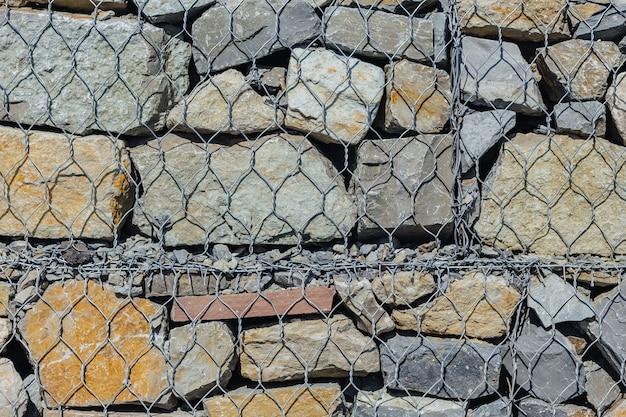 Gitterwand und textur steine Premium Fotos