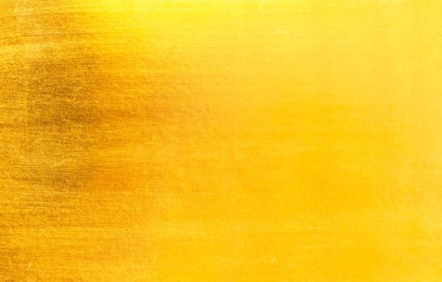 Glänzende gelbe blattgoldfolie Premium Fotos
