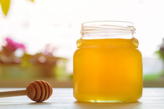 Glas honig. Premium Fotos