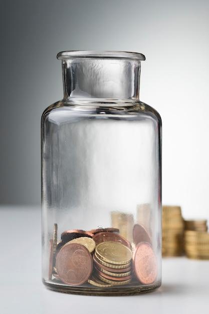 Glas mit münzen sparen Kostenlose Fotos