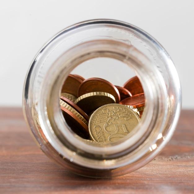 Glas mit münzen Kostenlose Fotos