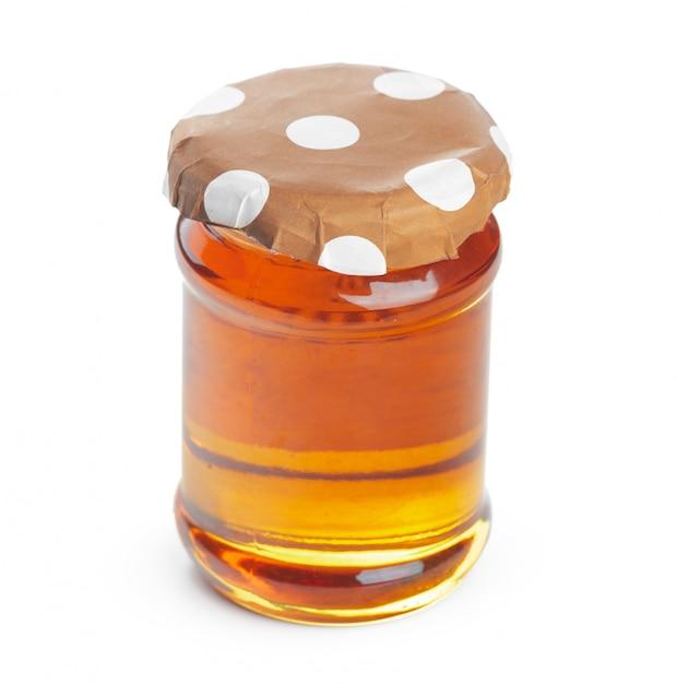 Glasgefäß mit dem süßen honig getrennt auf weiß Premium Fotos