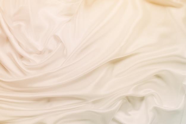 Glatter eleganter goldener silk hochzeitshintergrund getont Premium Fotos