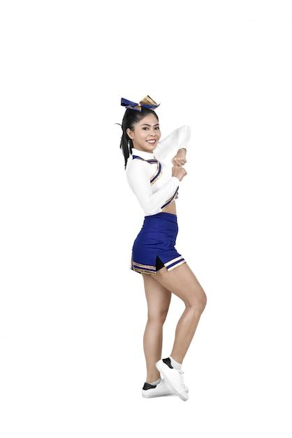 Glückliche asiatische cheerleaderin in aktion Premium Fotos