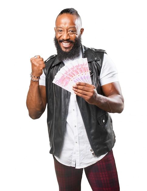 Glücklicher mann mit geld in der hand Kostenlose Fotos